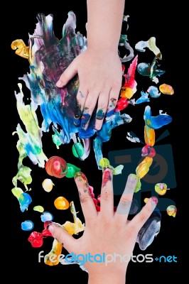 closeup-of-little-children-hands-doing-finger-painting-100389074