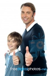 confident-father-and-son-duo-gesturing-thumbs-up-100177610.jpg